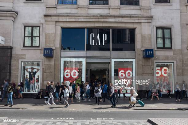 People walking in front of a GAP clothing shop in London London is the Capital city of England and the United Kingdom it is located in the south east...