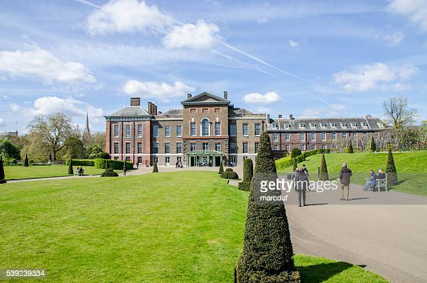 People walking in front of  Kensington Palace