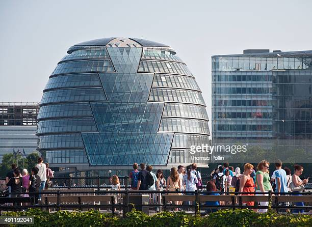 CONTENT] People walking in front of London City Hall with its bulbshape seen from Tower Hill