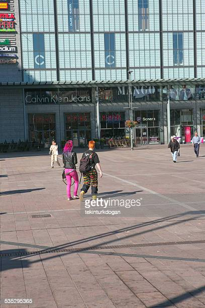People walking in front of modern building at helsinki finland