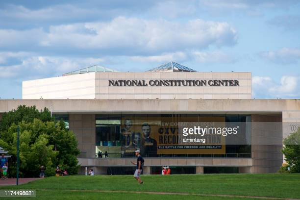 people walking in front of national constitution center in philadelphia - national constitution center stock pictures, royalty-free photos & images