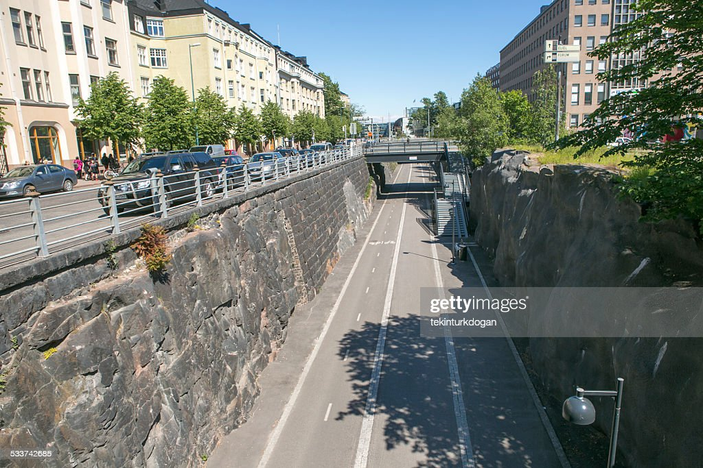 People walking in front of old buildings at helsinki finland : Stock Photo