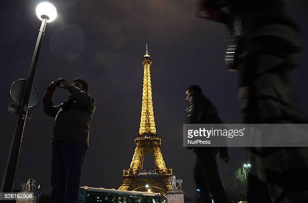 People walking in front of The Eifel Tower in Paris, France, on December 11, 2015