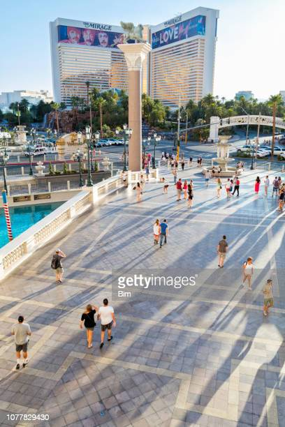 people walking in front of venetian resort hotel in las vegas, nevada, usa - the mirage las vegas stock pictures, royalty-free photos & images