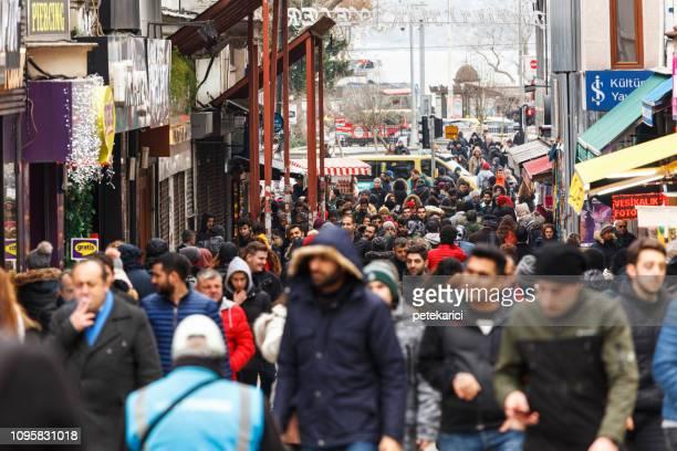 people walking in kadıköy fish market - kadikoy stock photos and pictures