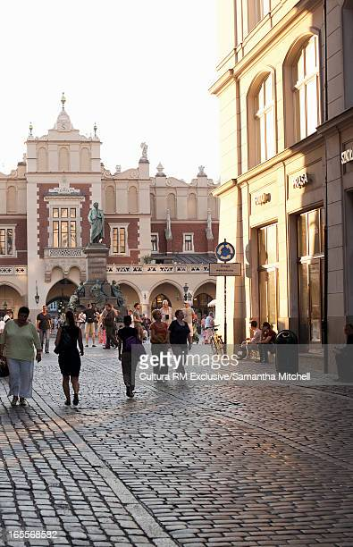 People walking in Krakow town square