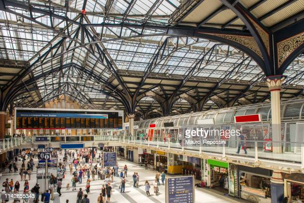 people walking in liverpool street station at the city of london, england, uk. - industrial revolution stock pictures, royalty-free photos & images