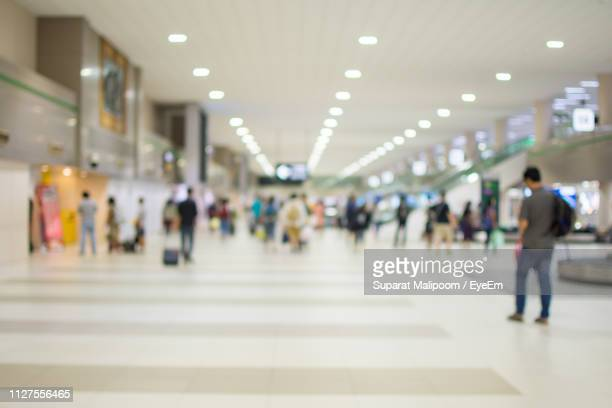people walking in mall - shopping mall stock pictures, royalty-free photos & images