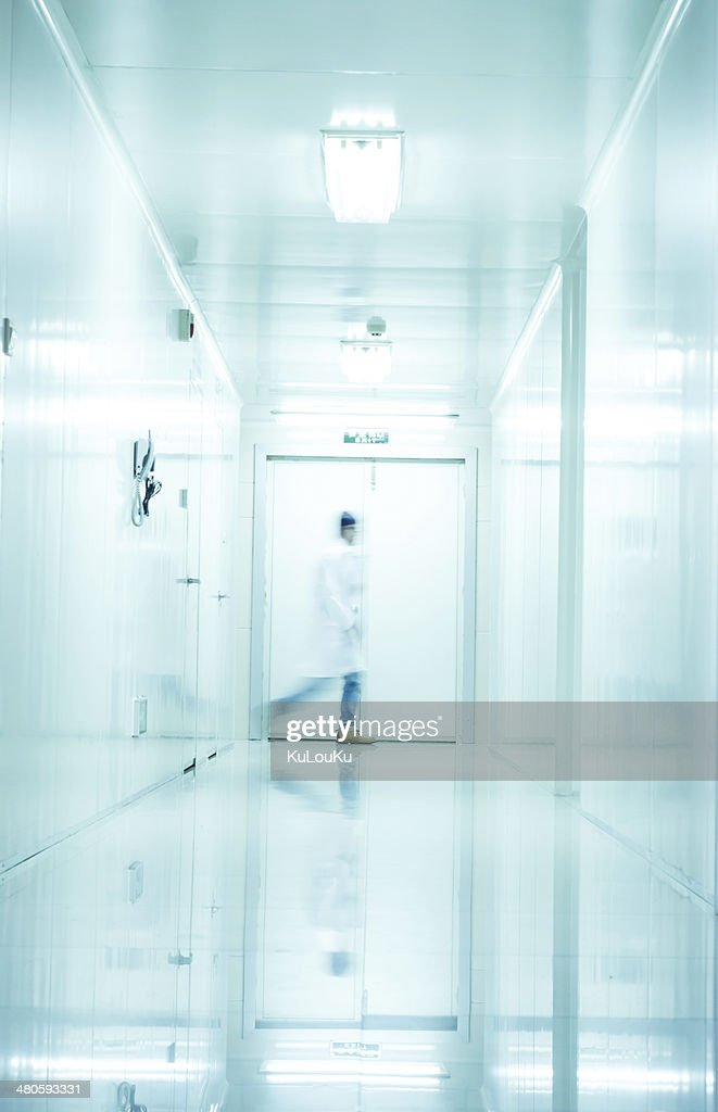 people walking in modern laboratory,abstract blur : Stock Photo