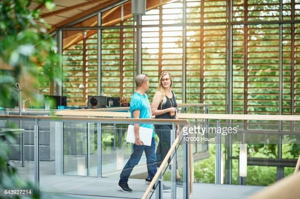 People walking in modern office.