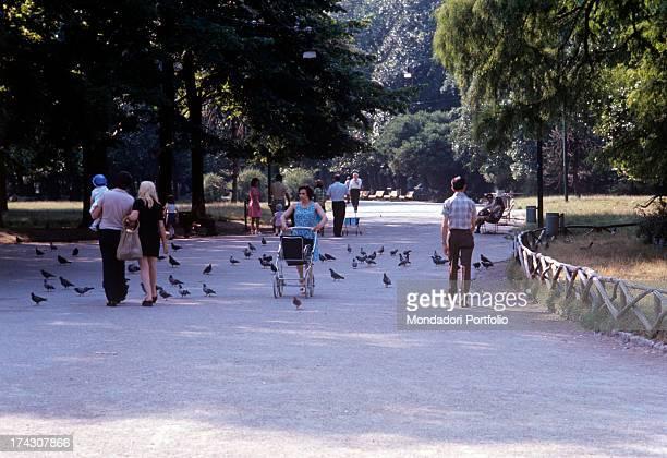 People walking in Parco Sempione Milan 1974