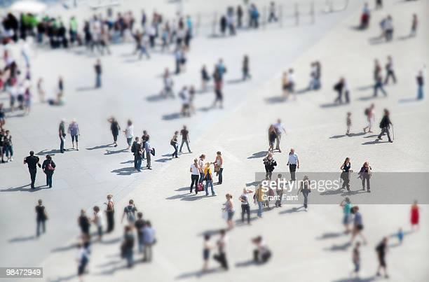 people walking in plaza - large group of people stock-fotos und bilder