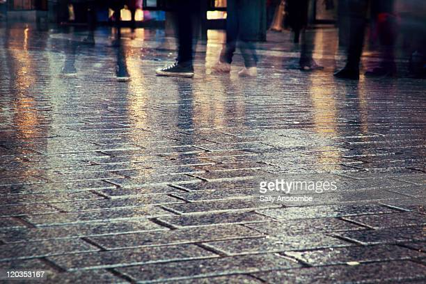 people walking in rain - merseyside stock pictures, royalty-free photos & images