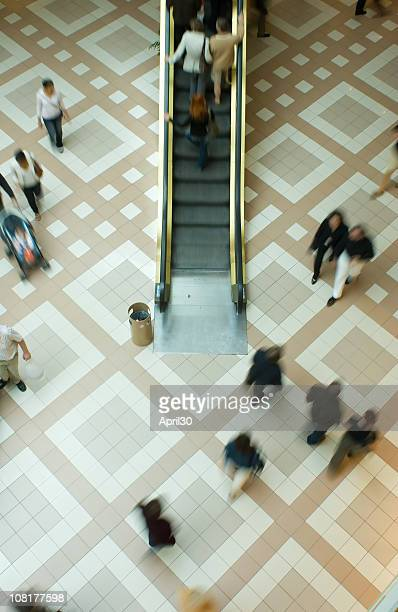 People Walking in Shopping and Escalator