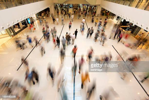 people walking in shopping - shopping mall stock pictures, royalty-free photos & images