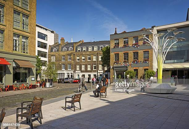 People walking in St John's Square in Clerkenwell