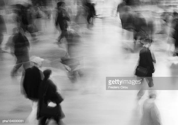 people walking in street, blurred, b&w - moving past stock pictures, royalty-free photos & images