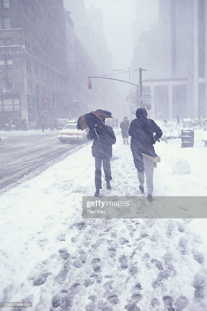 People walking in street in snowstorm, NYC, NY, USA : Stock Photo
