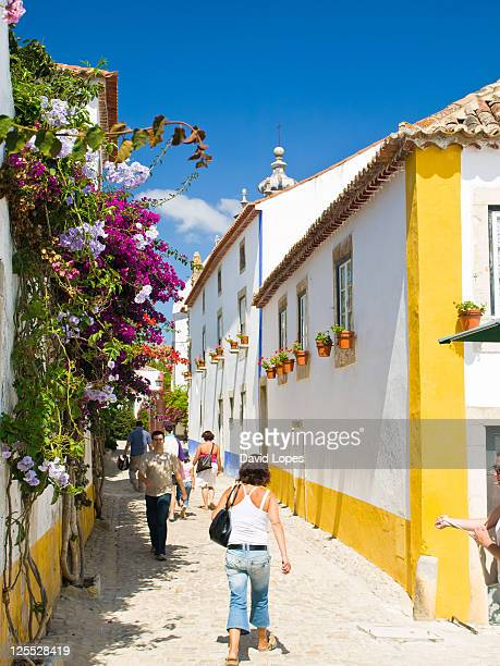 People walking in streets of Obidos