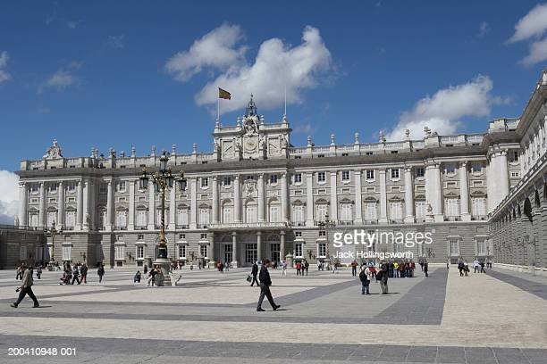 People walking in the courtyard of an ornate government building