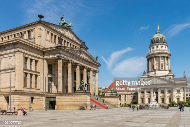 people walking in the gendarmenmarkt square in the central mitte district of berlin city, germany. - konzerthaus berlin stock pictures, royalty-free photos & images