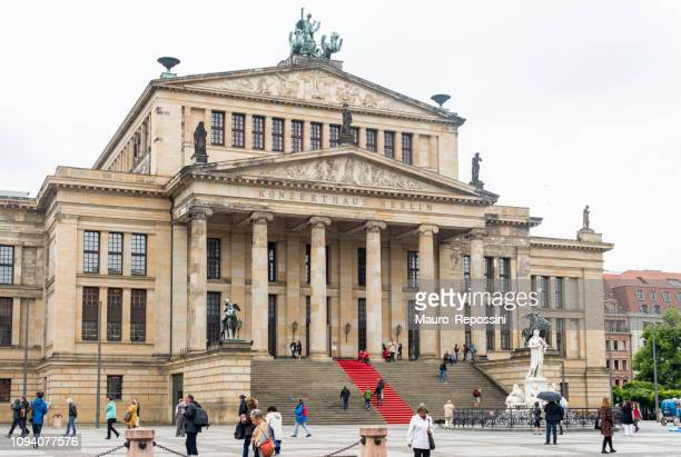 people walking in the gendarmenmarkt square in the mitte district of central berlin city, germany. - konzerthaus berlin stock pictures, royalty-free photos & images