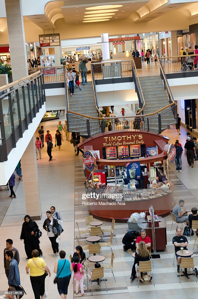 People walking in the hall of a large shopping center. A... : News Photo