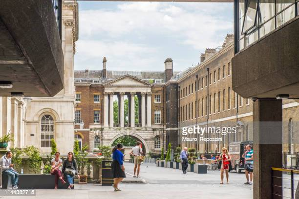 people walking in the king´s college situated on the south side of the strand in central london, england, uk. - king's college london stock pictures, royalty-free photos & images