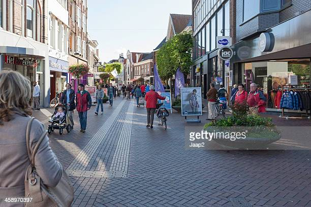 people walking in the shopping area downtown almelo, netherlands - overijssel stock pictures, royalty-free photos & images