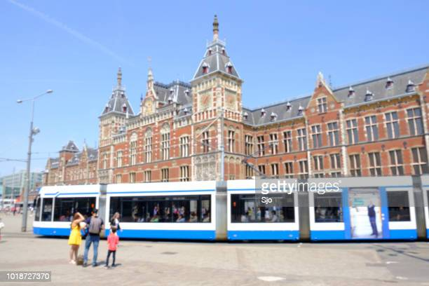 People walking in the square in front of Amsterdam Central station