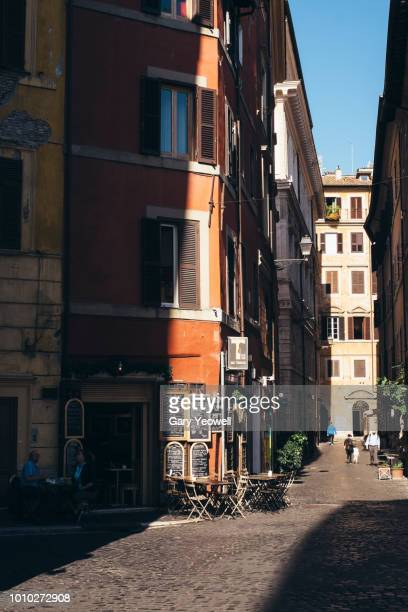 people walking in the street in the san't angelo district of rome - yeowell stock pictures, royalty-free photos & images