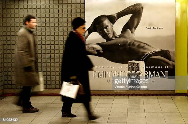 People walking in the underground pass a poster featuring David Beckham modeling underwear in the latest Emporio Armani campaign on December 19 2008...