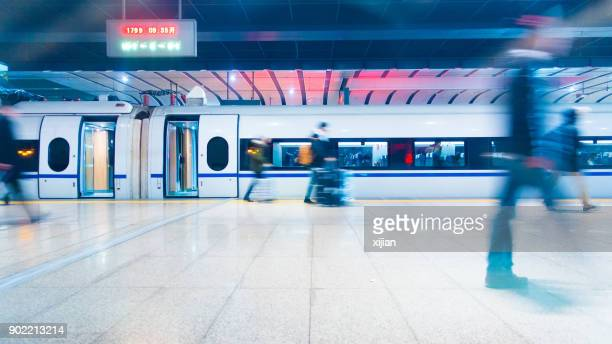 people walking in train station - subway platform stock pictures, royalty-free photos & images
