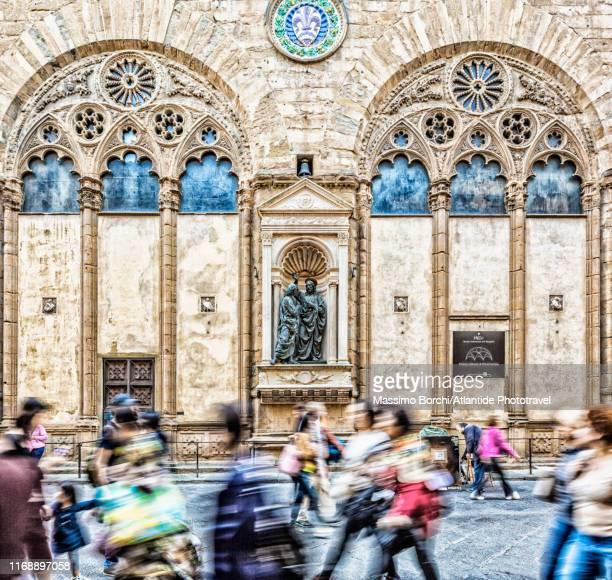 people walking near chiesa di orsanmichele - image stock pictures, royalty-free photos & images