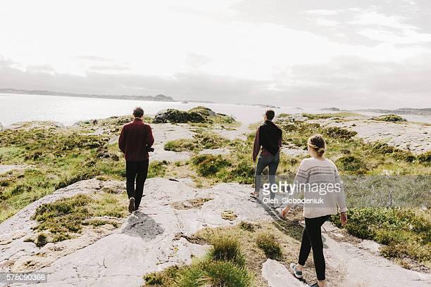 People walking near the sea