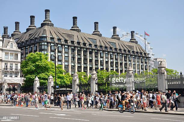 CONTENT] People walking near Westminster Palace in front of Portcullis House