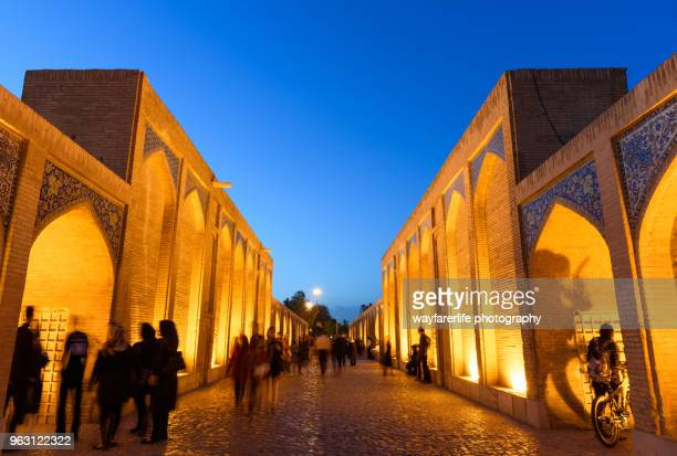 people walking on a bridge at night - shiraz stock photos and pictures