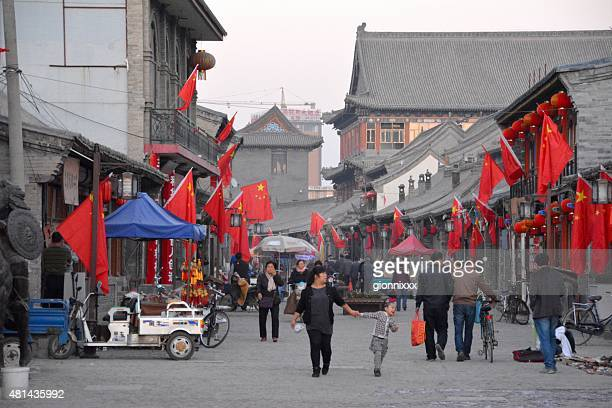People walking on an old street in Hohhot, Inner Mongolia