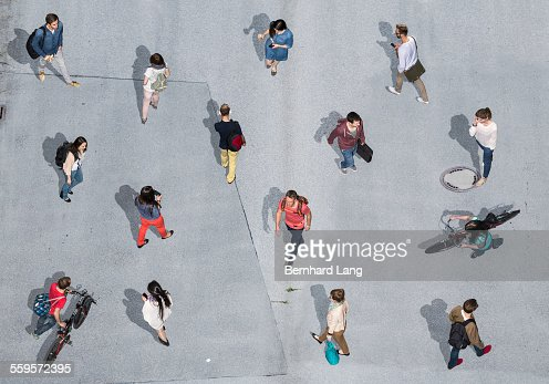 People Walking On Asphalt Underground Aerial View Stock Shot Of A Person