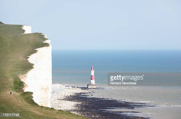 people walking on beachy head - beachy head stock photos and pictures