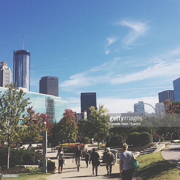 people walking on city street against sky - atlanta stock photos and pictures