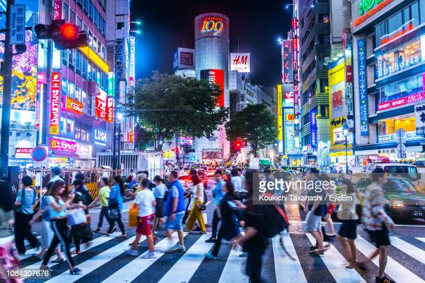 people walking on city street - tokyo japan stock pictures, royalty-free photos & images