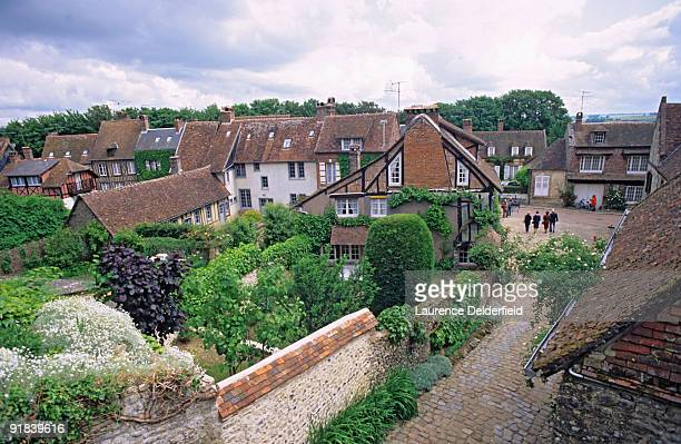 people walking on cobblestone street in gerberoy, france - oise stock photos and pictures