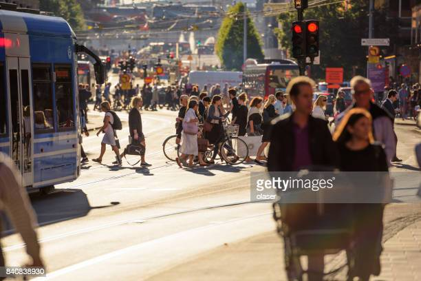 people walking on crowded street - stockholm stock pictures, royalty-free photos & images