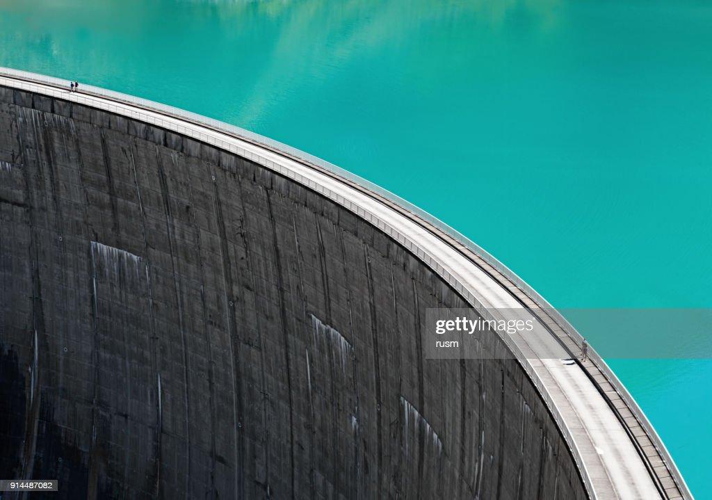 People walking on edge of Stausee Mooserboden Dam, Kaprun, Austria : Stock Photo