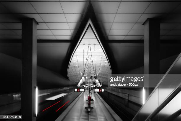 people walking on escalator,germany - andy dauer stock pictures, royalty-free photos & images