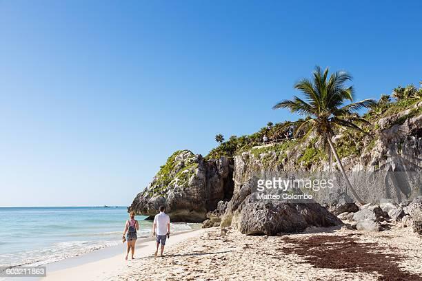 People walking on idyllic beach in Tulum, Mexico