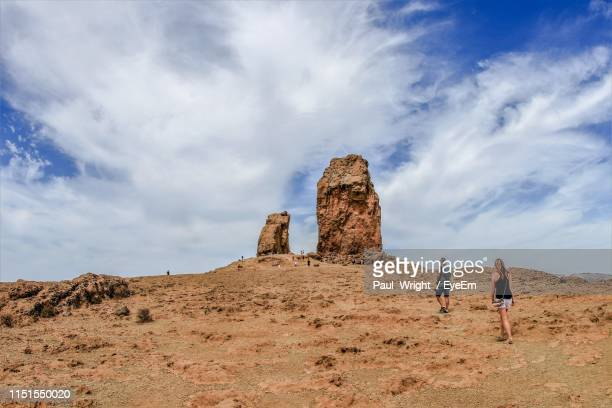 people walking on landscape against sky - tejeda stock pictures, royalty-free photos & images