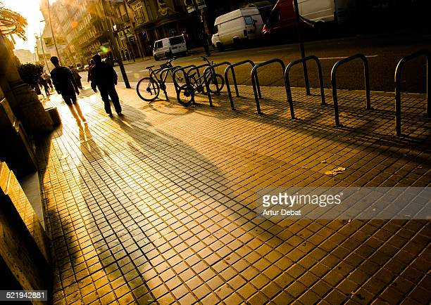 People walking on morning with big shadows sunrise