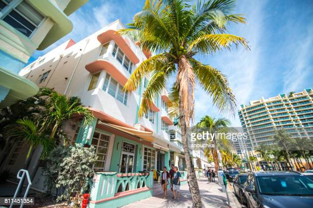 people walking on ocean drive, south beach, miami beach, usa - south beach stock pictures, royalty-free photos & images